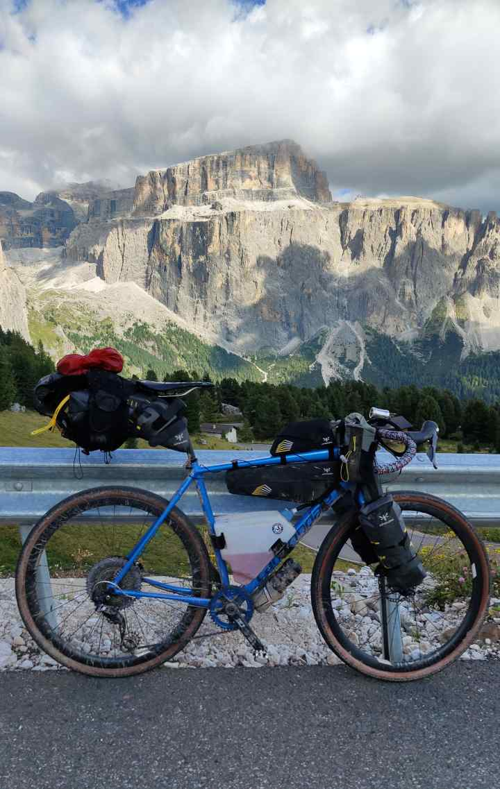 Chris' fully laden gravel bike on a road climb in the Dolomites