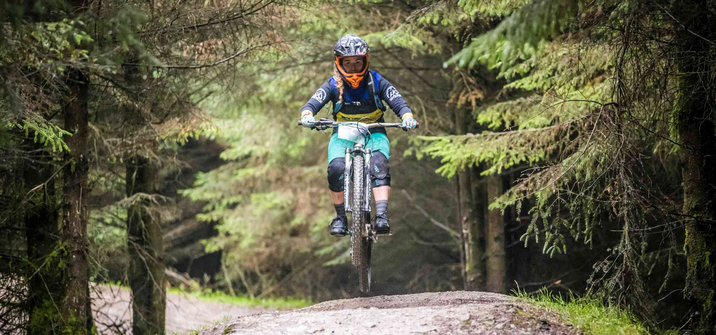 Alice getting air on her mountain bike