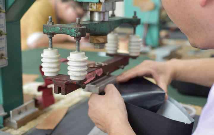 A technician operates an RF welding machine