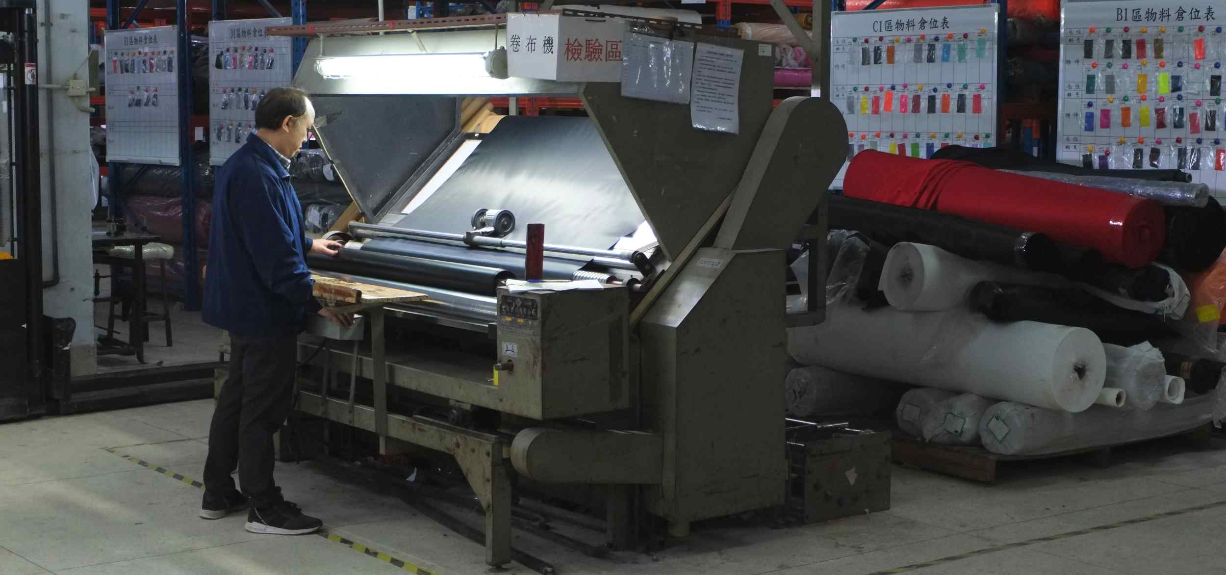 A technician uses a machine to process fabric