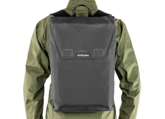 Close-up of the Apidura Backpack in the back of a man
