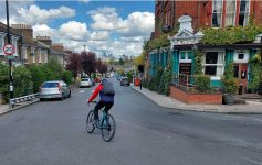 Josie cycling on a quiet London street