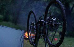A bike upside down at a campsite