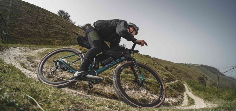 Liam Yates riding the Canyon Grizl with Apidura x Canyon Packs on a gravel trail