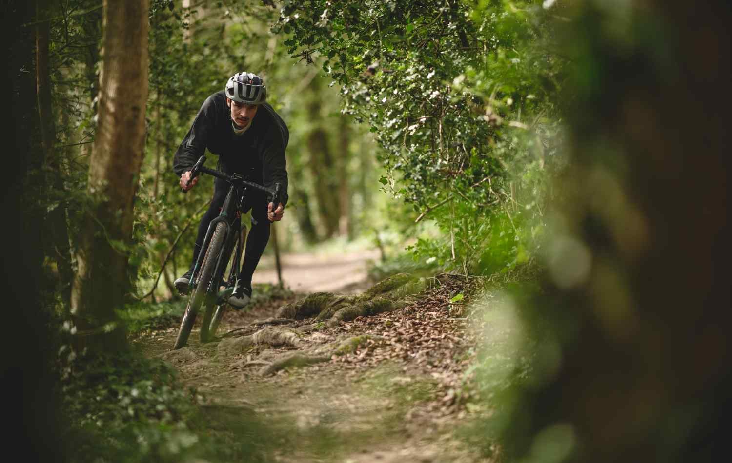 Liam Yates riding a Canyon Grizl down an off-road trail