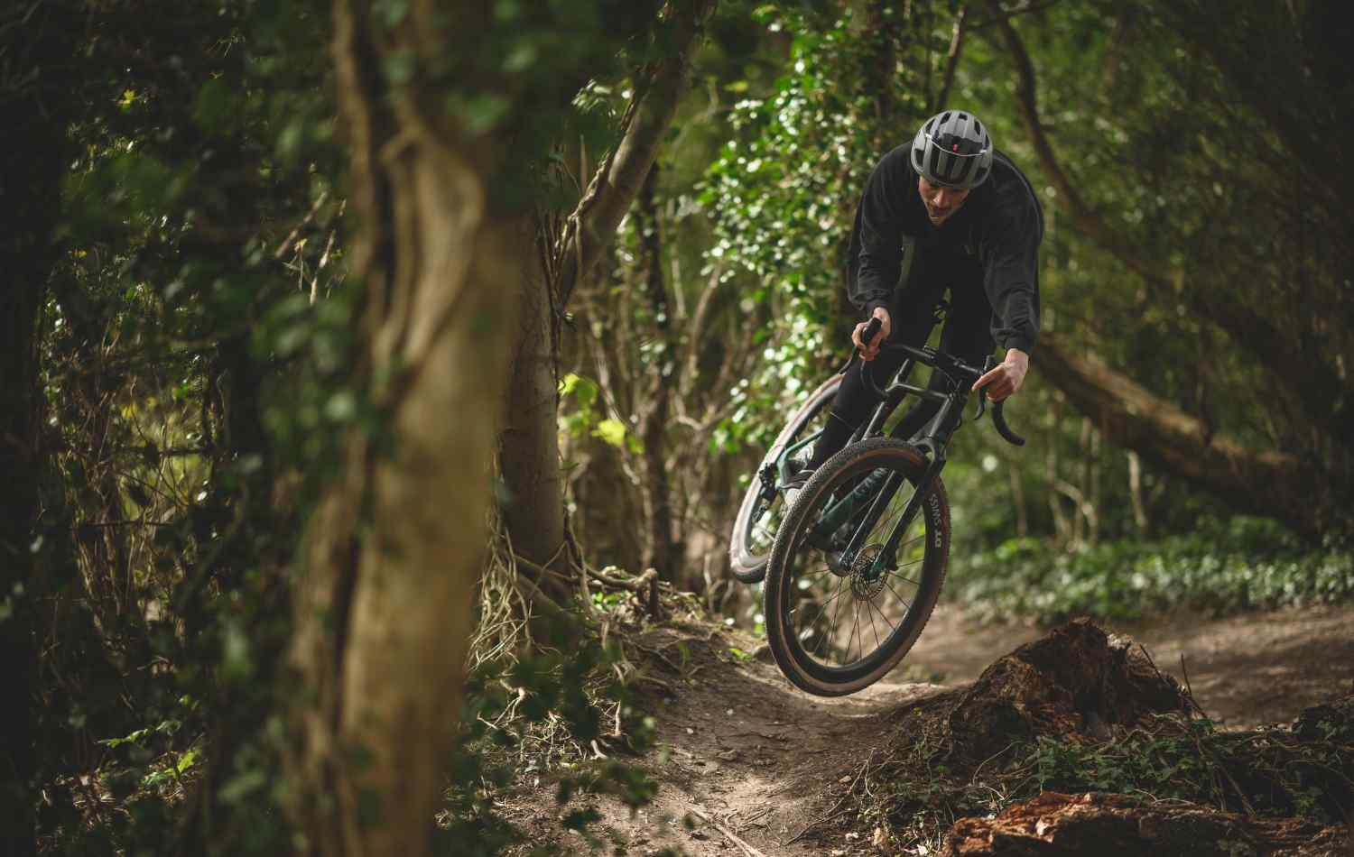 Liam Yates getting playful on a Canyon Grizl on a trail