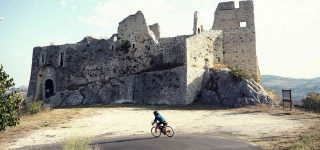 Mario rides past the remains of a castle