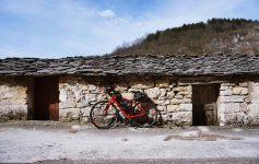 Mario's bike leans against an ancient cottage