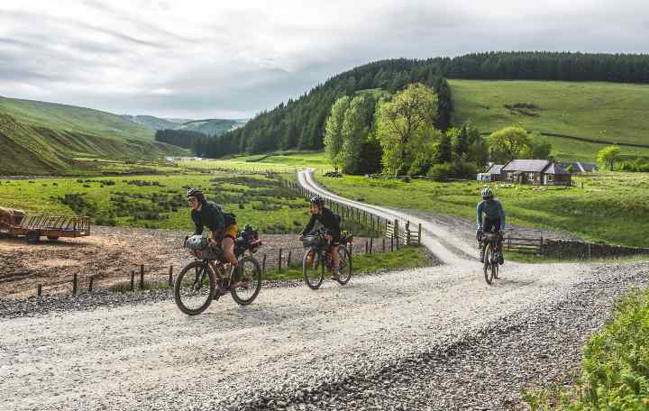 The Steezy Collective ride along a gravel road in the Pennines