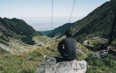 A checkpoint volunteer looks out over the Transfăgărășan