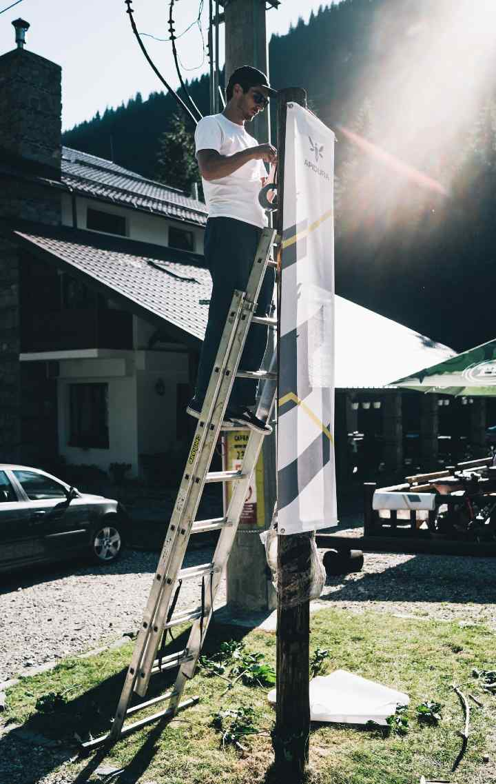 An Apidura team member hangs out a banner to make the control easier to find