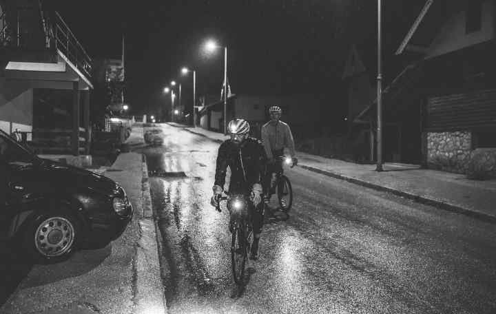Riders arrive at the checkpoint late at night, in pouring rain