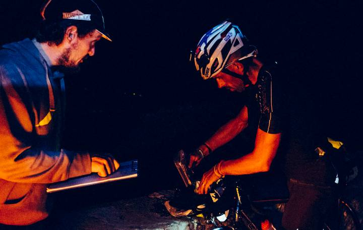 Mike Hall greets a rider at a checkpoint