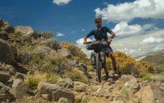 Gonzalo walks his bike down a rock garden