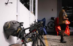 A Randonneur's bike outside a store during a ride
